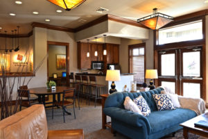 Interior with sitting areas, communal kitchen, breakfast bar
