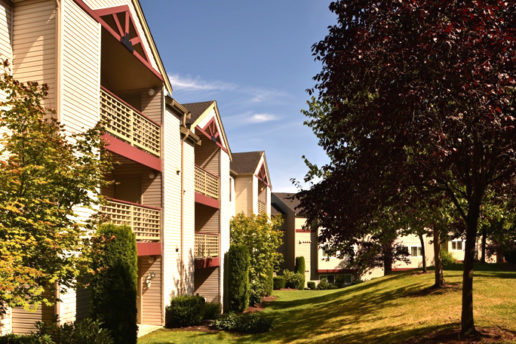 Exterior of balconies, grass lawn and trees