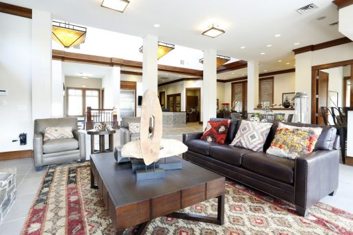 seating area with couch and chair, coffee table, decor