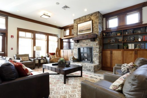 lodge room with fireplace, sitting areas, book shelves